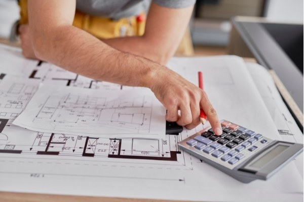 close up of calculating the costs of renovation