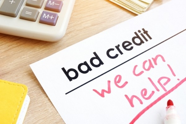 """calculator and document with words """"bad credit we can help"""""""