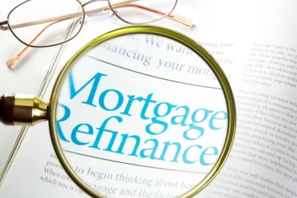 """Words """"mortgage refinance"""" with magnifying glass"""