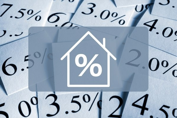 House and interest rate icon with papers on the background