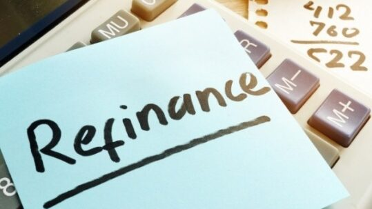 "Word ""Refinance' written on a sticky note"